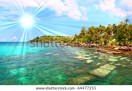 Sunny paradise beach under sky with clouds - stock photo