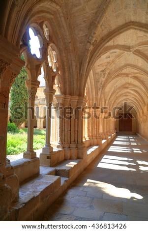 Sunny patio along the cloister of the Royal Abbey of Santa Maria de Poblet (Poblet Monastery) in Catalonia, Spain - stock photo