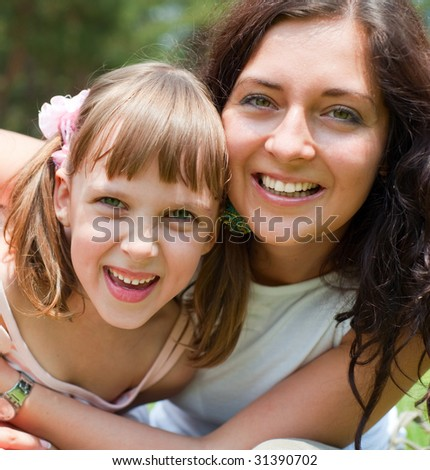 sunny picture of happy family - stock photo