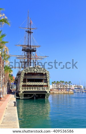 Sunny pier and historical ship in the harbor of Alicante, Spain