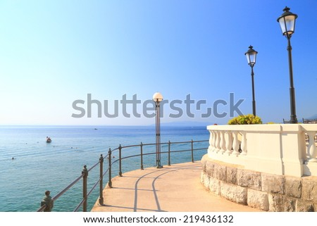 Sunny pier by the Adriatic sea shore, Opatija, Croatia - stock photo