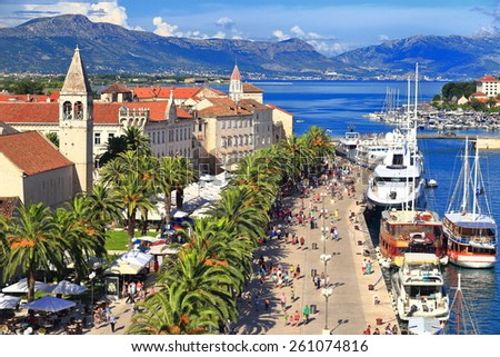 Sunny promenade along the pier of old Venetian town, Trogir, Croatia - stock photo