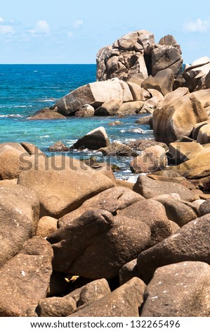 Sunny rocky ocean shore in the Seychelles Islands - stock photo