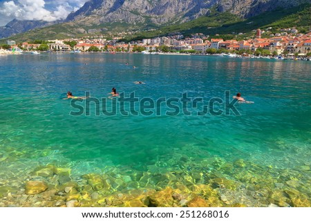 Sunny shore of the Adriatic sea near the Dalmatian coastline, Makarska, Croatia - stock photo