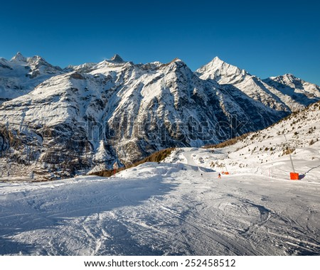 Sunny Ski Slope and Mountains Peaks in Zermatt, Switzerland - stock photo