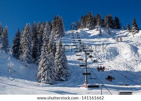 Sunny Ski Slope and Ski Lift near Megeve in French Alps, France - stock photo