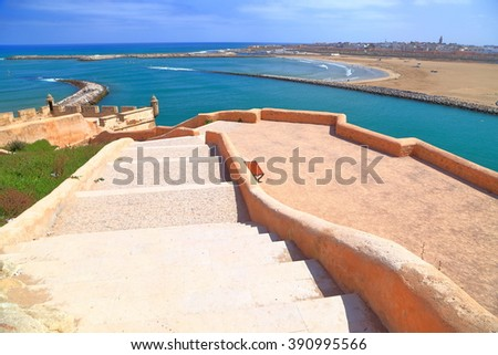 Sunny stairs of the Kasbah of the Udayas above the Bou Regreg river and Atlantic ocean in Rabat, Morocco - stock photo