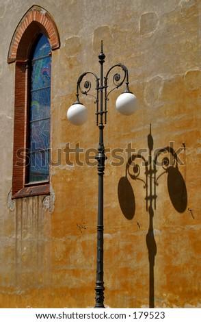 Sunny street in Pisa, Italy - stock photo