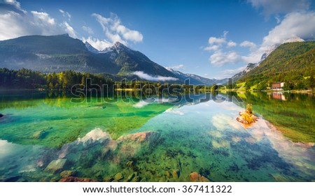 Sunny summer morning on the Hintersee lake in Austrian Alps. Salzburg, Austria, Europe. - stock photo
