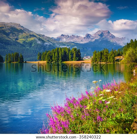 Sunny summer scene on the Champferersee lake. Silvaplana village in the morning mist. Alps, Switzerland, Europe. - stock photo