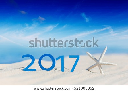 Sunny tropical beach and 2017 happy new year. Season vacation and holiday concept