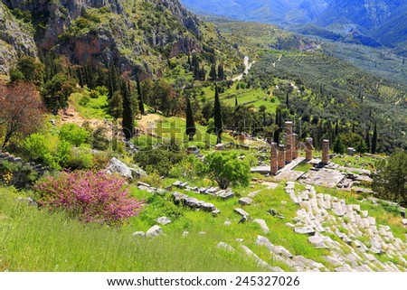 Sunny valley at Delphi with vivid vegetation surrounding the remains of the ancient temple of Apollo, Greece - stock photo