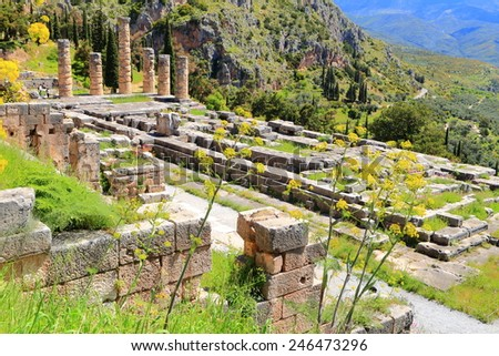 Sunny valley on Parnassus Mountains and Greek temple of the sun god Apollo, Delphi, Greece - stock photo