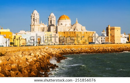 Sunny view of  Cathedral and  ocean coast. Cadiz  - stock photo