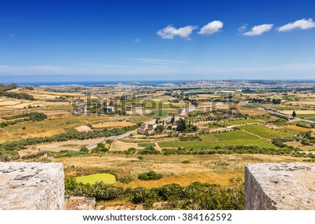 Sunny view of surrounding fields from tower of Mdina, Malta.