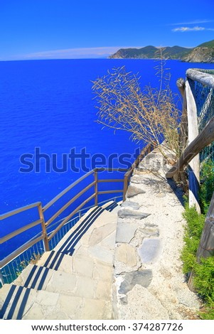 Sunny walkway and stairs above the Ligurian coastline in Vernazza, Cinque Terre, Italy - stock photo