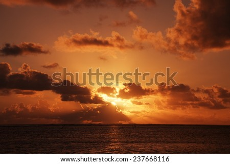 Sunrays from behind gray Clouds above South Pacific Ocean - Rarotonga, Cook Islands, Polynesia