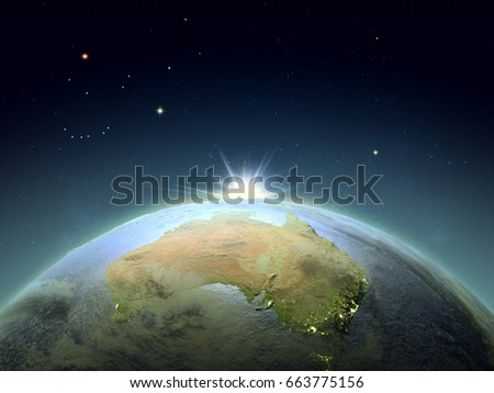 Sunrise above Australia from space. Concept of new start, hope, new light. 3D illustration with detailed planet surface. Elements of this image furnished by NASA.