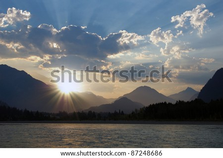 Sunrise above mountains - stock photo