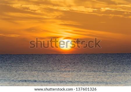 Sunrise above the sea - stock photo