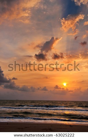 Sunrise after the storm, in Khanom bay , Nakhon Si Thammarat, Thailand. - stock photo