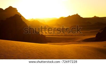 Sunrise - Akakus (Acacus) Mountains, Sahara, Libya - Bizarre sandstone rock formations - stock photo