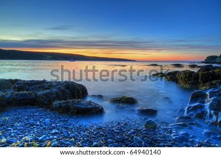 Sunrise along the Atlantic Coastline. - stock photo