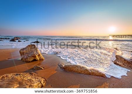 Sunrise and beach. - stock photo