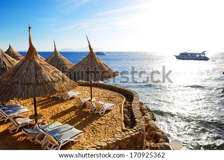 Sunrise and beach at the luxury hotel, Sharm el Sheikh, Egypt - stock photo