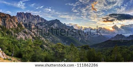 Sunrise and cloudscape over Bavella massif and mountain, Corsica, France. - stock photo