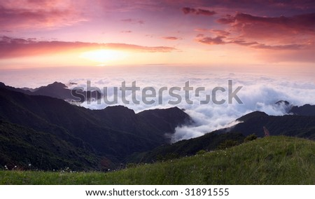 sunrise and grand cloudscape from the mountaintop - stock photo