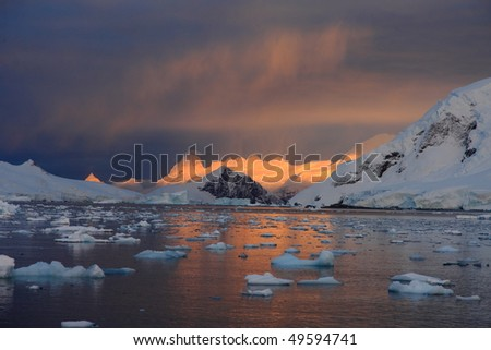 Sunrise and ice floe in Antarctica - stock photo