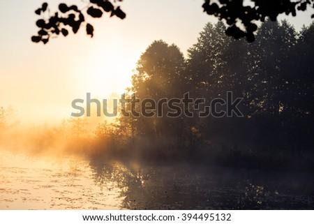 Sunrise and mist in beautiful lake - stock photo