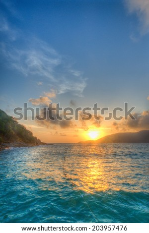 Sunrise and ocean with open sky on Perhentian Island, Terengganu, Malaysia
