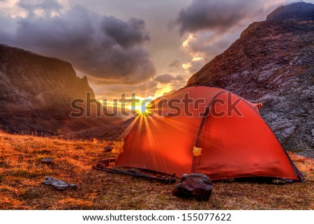 Sunrise and Tent in Autumn in Lapland - stock photo