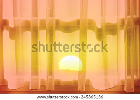 Sunrise and window with curtains morning light  abstract background - stock photo