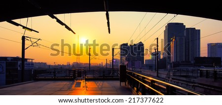 Sunrise at Electric Railway Station with Cityscape in Central Urban, Airport Rail Link in Bangkok, Thailand - stock photo