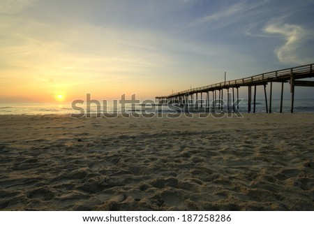 Sunrise at fishing pier on the Outer Banks, North Carolina - stock photo