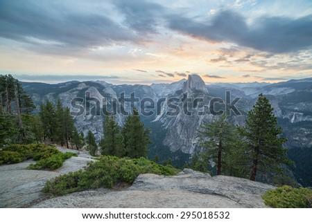 Sunrise at Half Dome peak in Sierra Nevada mountains, Yosemite National Park, California - stock photo