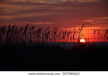 Sunrise at Kure Beach North Carolina on a warm summer morning.