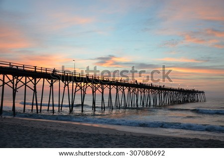 Sunrise at Kure Beach North Carolina on a warm summer morning near the pier.