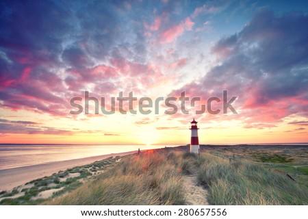 sunrise at Lighthouse List East on Sylt. - stock photo