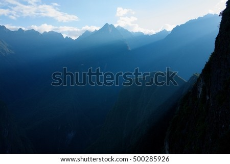 Sunrise at machu picchu. Sun gate view to an andes mountains