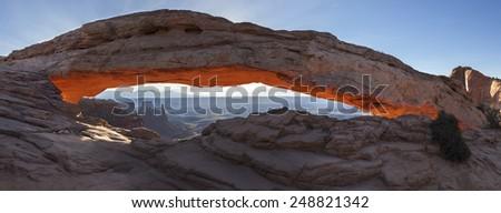 Sunrise at Mesa Arch in Canyonlands National Park near Moab, Utah, USA - stock photo