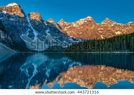 Sunrise at Moraine lake with in the valley of ten peaks in Banff National Park (Canada, about 5:50 am in June) - stock photo