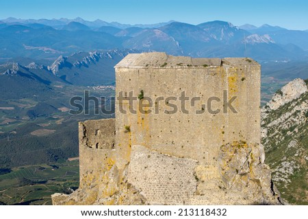Sunrise at Queribus Cathar Castle, general view to Maury valley in Corbiere and Languedoc - stock photo