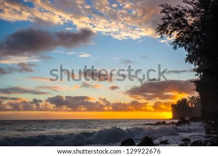 Sunrise at rocky Hawaiian beach, Big Island, Hawaii - stock photo