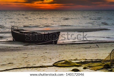 Sunrise at sandy beach of Baltic Sea near village of fishermen - stock photo