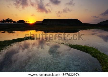 Sunrise at tanjung aan, kuta lombok beach, lombok, indonesia. - stock photo