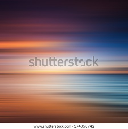 Sunrise at the beach. Blurred panning motion. Abstract seascape - stock photo